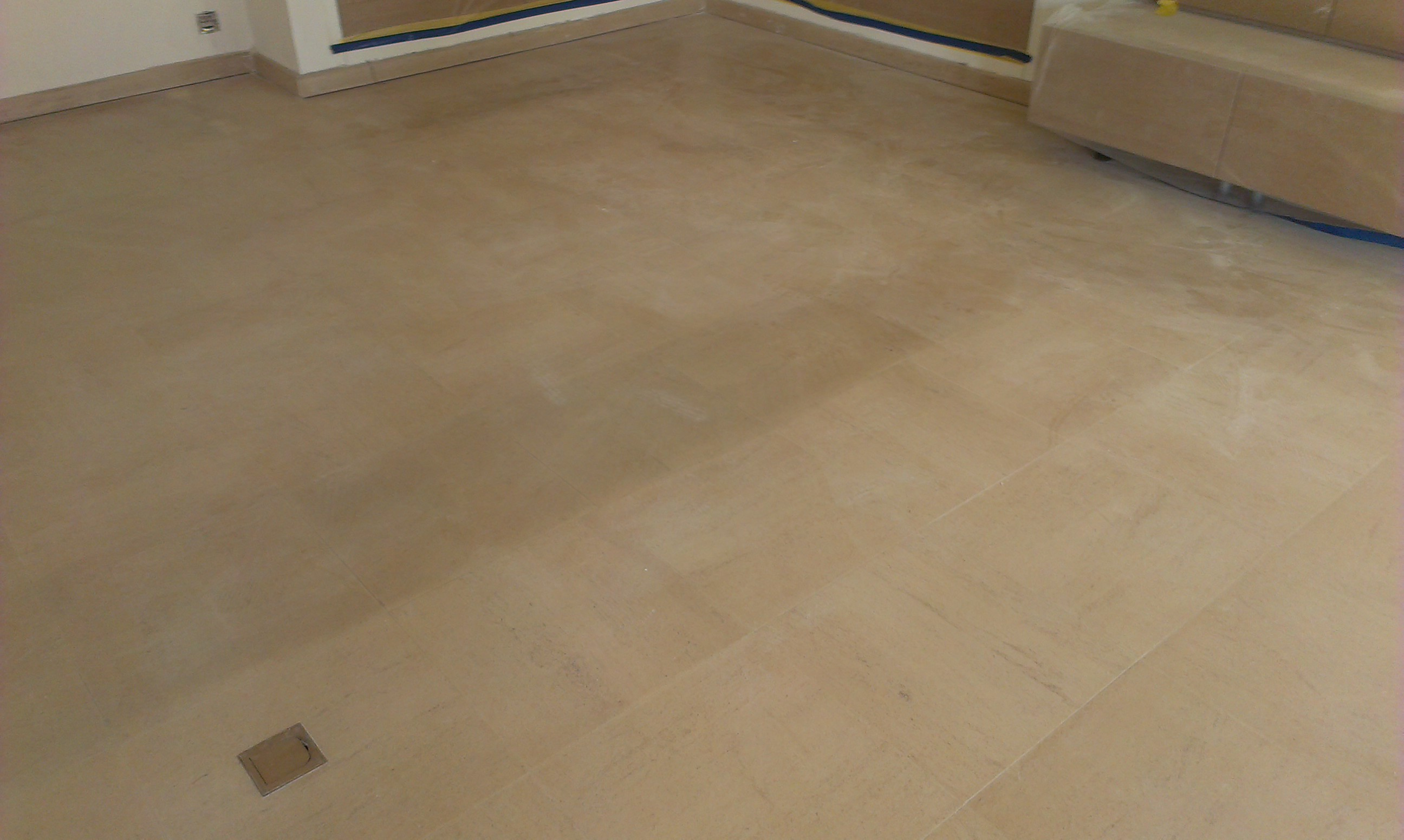 The natural stone floor after removing the carpeting and before cleaning and sealing